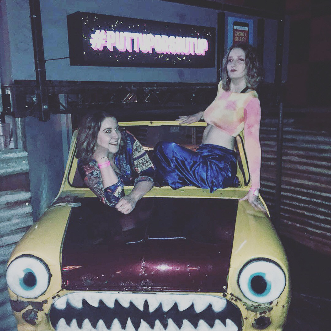 Girls sitting on model mini